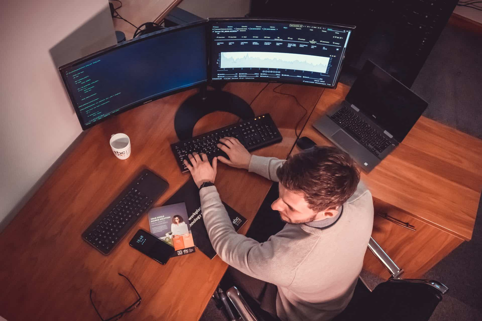 Birdseye view of man with cyber security at desk