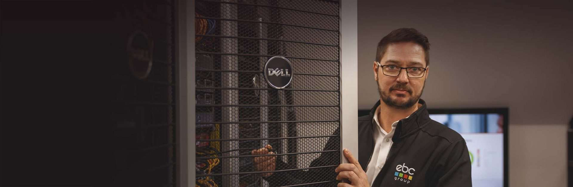 Man next to cloud server cage door