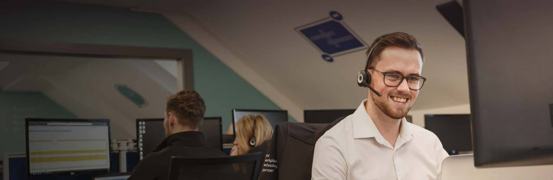 Man on IT helpdesk with headset contact