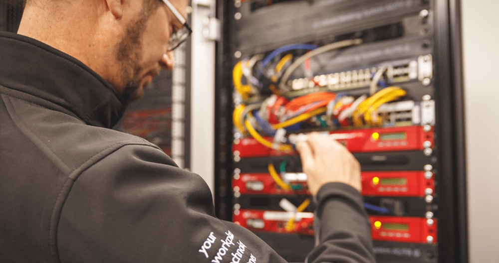 Engineer in data centre with server